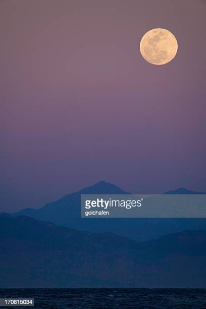 full moon on purple sky - coastline stock pictures, royalty-free photos & images