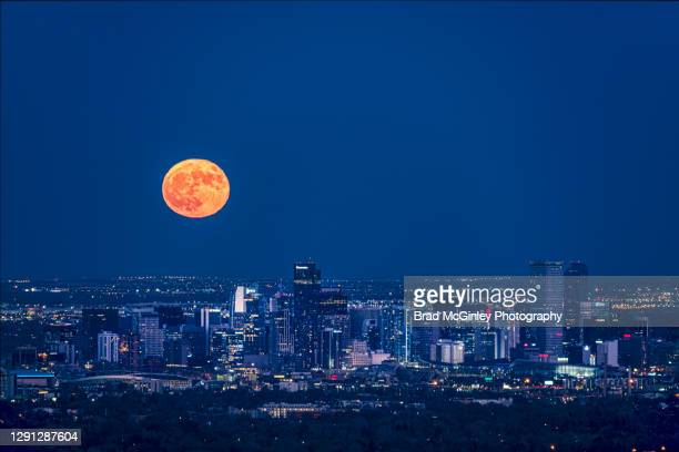 full moon over denver - denver stock pictures, royalty-free photos & images