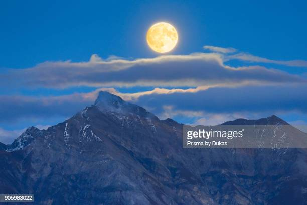 Full moon over Grisons Alps Grisons Switzerland