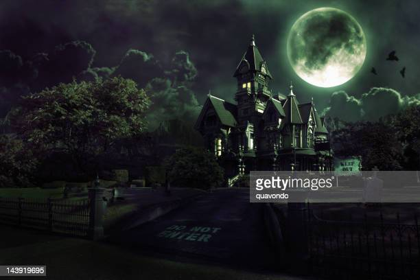 full moon over haunted house with graveyard for halloween - spooky stock pictures, royalty-free photos & images