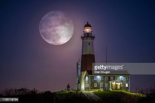 full moon over montauk point lighthouse - harvest moon stock pictures, royalty-free photos & images