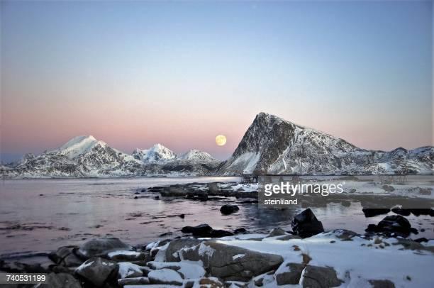 Full moon over mountains, Sandnes, Flakstad, Lofoten, Nordland, Norway