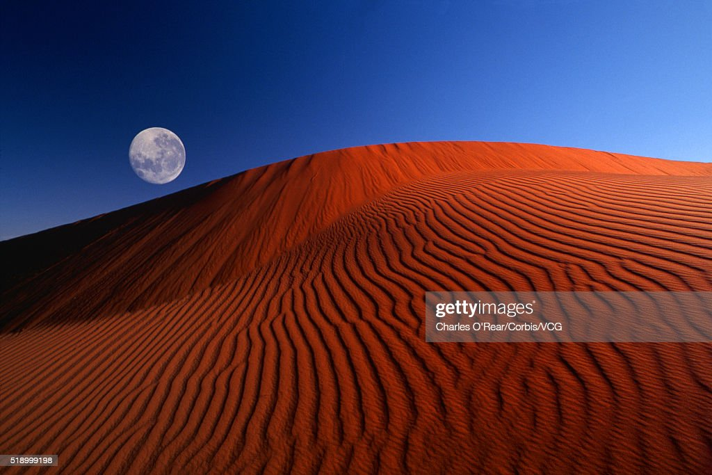 Full Moon over Red Dunes : Stock Photo