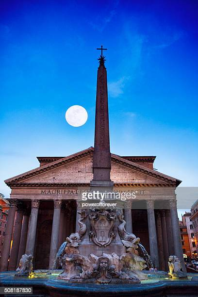 full moon over the pantheon at dusk in rome, italy - pantheon rome stock photos and pictures
