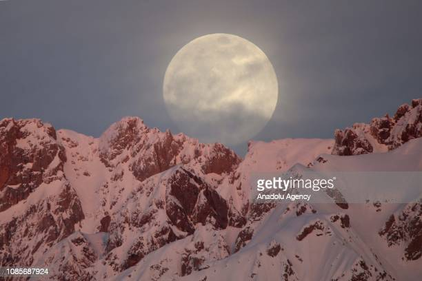 Full moon rises behind snowcovered mountains in Hakkari province of Turkey on January 20 2019