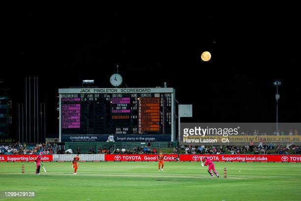 Full moon rises during the Big Bash League match between the Sydney Sixers and the Perth Scorchers at Manuka Oval, on January 30 in Canberra,...