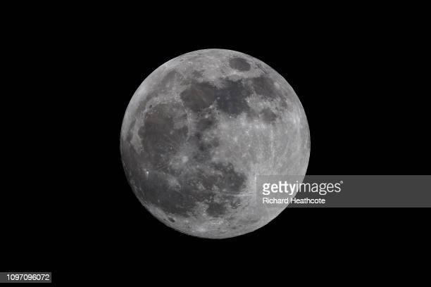A full Moon rises over Southern England ahead of a total Lunar Eclipse and the possible sighting of a Blood Moon on January 20 2019 in High Wycombe...