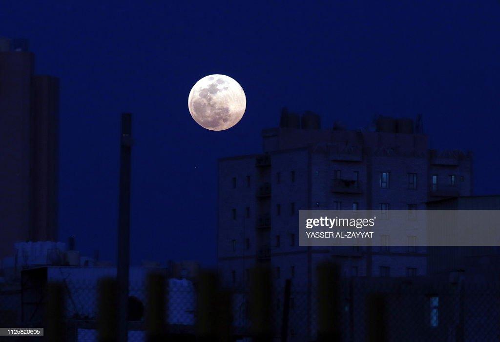 Full moon rises over the Kuwaiti capital, Kuwait City on