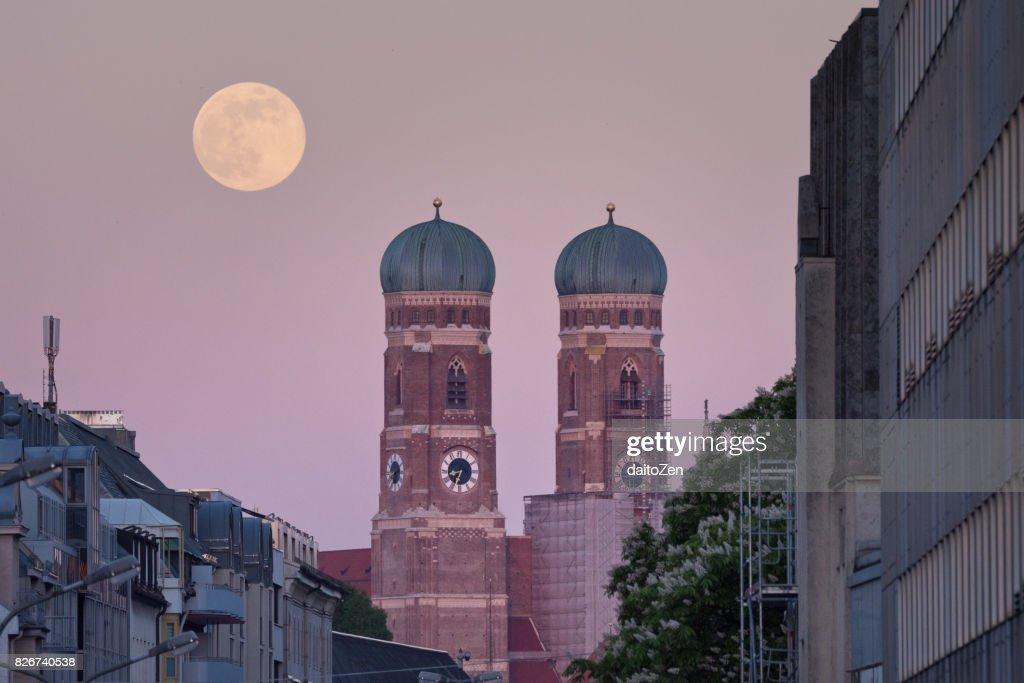 Full moon rising behind Munich Cathedral Frauenkirche, Munich, Bavaria, Germany : Stock Photo