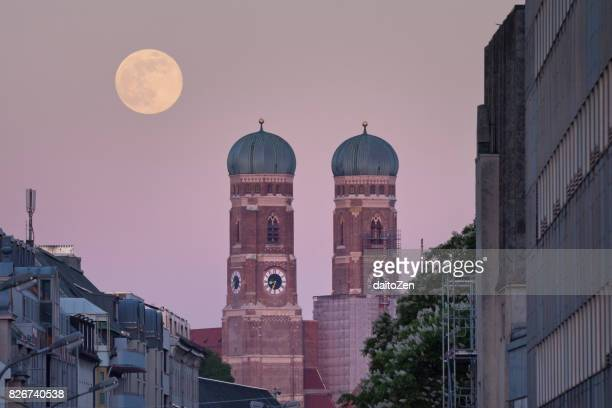 Full moon rising behind Munich Cathedral Frauenkirche, Munich, Bavaria, Germany