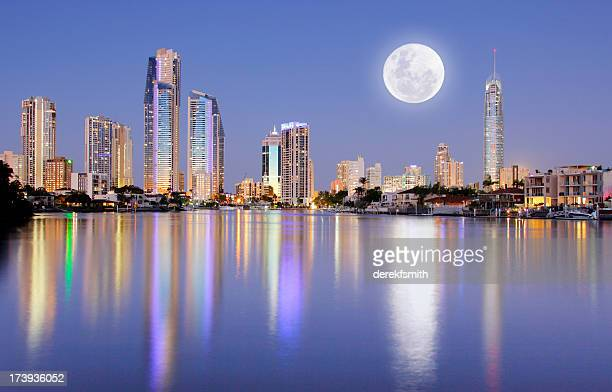 full moon rising over surfers paradise - gold coast queensland stock pictures, royalty-free photos & images