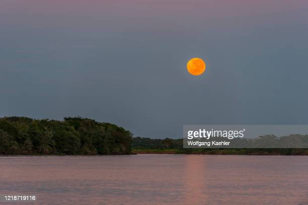 Full moon setting over the Cuiaba River at Porto Jofre in the northern Pantanal, Mato Grosso province in Brazil.
