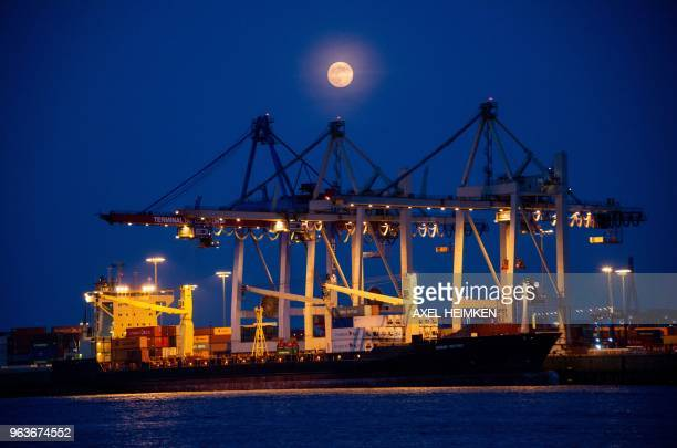 Full moon stands over the container terminal at the port of Hamburg, northern Germany on May 29, 2018. / Germany OUT