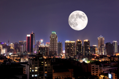 full moon upon lights of city - gettyimageskorea