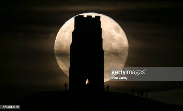 A full November moon which is known as a Beaver's Moon according to the native north Americans rises behind the Grade I listed St Michael's Tower on...