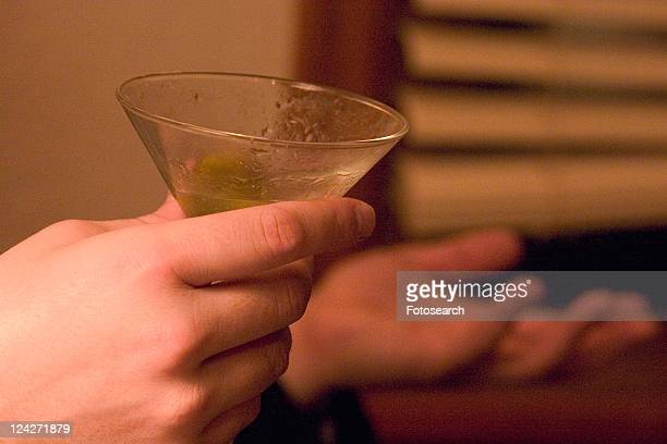 Full of conversation with martini in hand