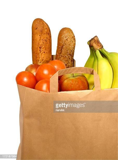Un sac en papier avec de la nourriture produits