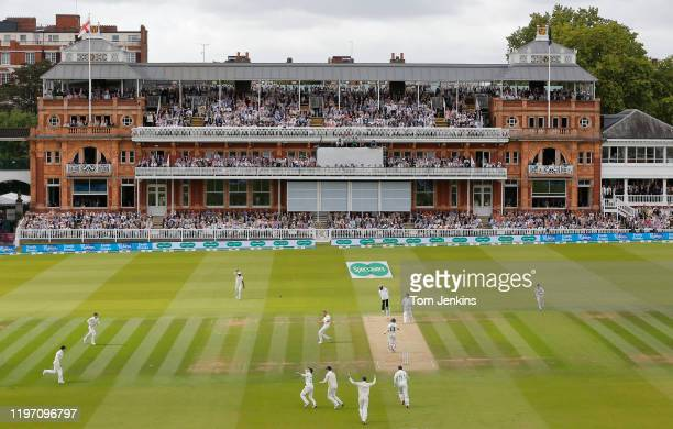 Full pavilion watches Rory Burns of England as he celebrates after catching Matthew Wade off the bowling of Stuart Broad during day four of the...