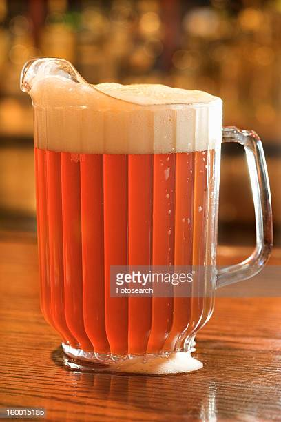 full pitcher of beer - pitcher stock pictures, royalty-free photos & images