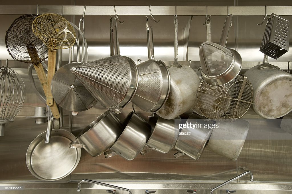 A Full Pot Rack In Commercial Kitchen Stock Photo