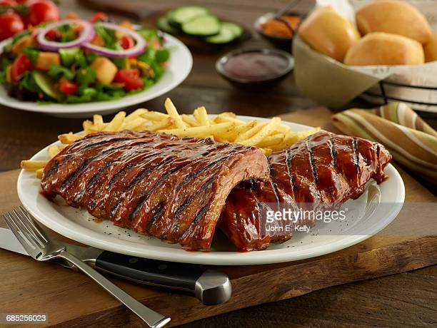 full rack of bbq pork ribs - barbeque sauce stock photos and pictures