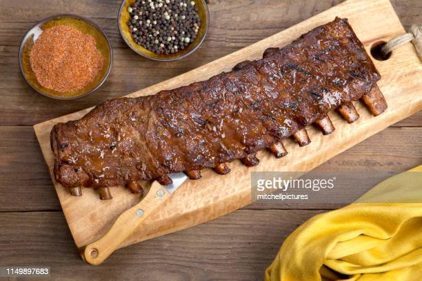 full rack of ribs - rack stock pictures, royalty-free photos & images