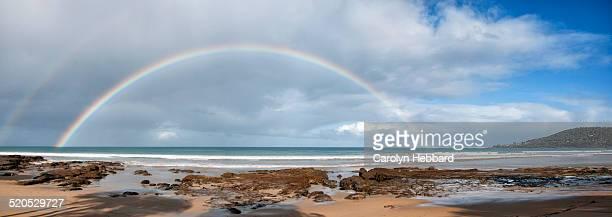 Full Rainbow Arc on Beach