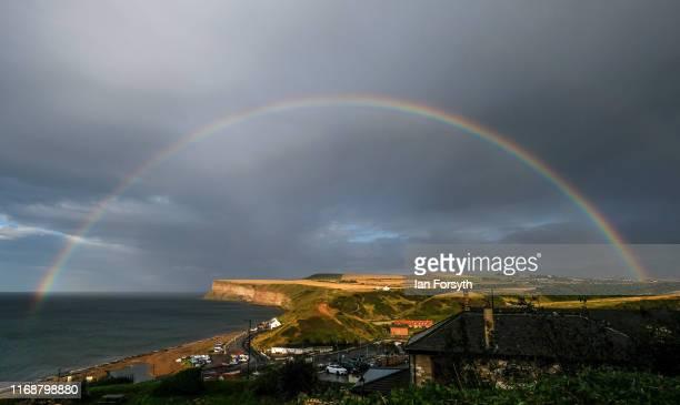 A full rainbow arcs across the sky over the coast on August 18 2019 in Saltburn By The Sea England