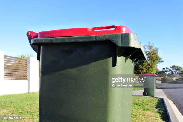 full rubbish bins in a front yard of houses in suburban street - rafael ben ari stock pictures, royalty-free photos & images