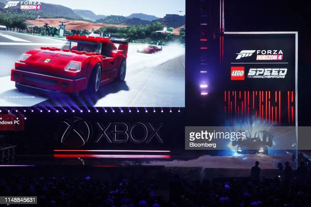 Full scale McLaren Senna made of LEGO bricks is unveiled, right, with the Forza Horizon 4 LEGO Speed Champions video game expansion during the...