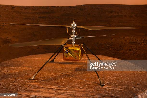 Full scale model of the experimental Ingenuity Mars Helicopter, which will be carried under the Mars 2020 Perseverance rover, is displayed at NASA's...