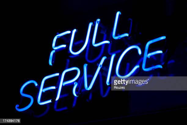 full service sign - neon letters stock photos and pictures