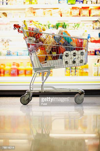 full shopping cart in grocery store - full stock pictures, royalty-free photos & images