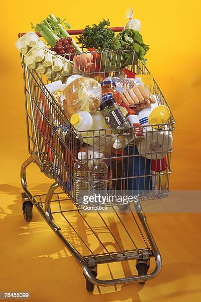 full shopping cart - overflowing stock pictures, royalty-free photos & images