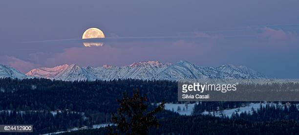 Full super moon over the Alps at sunrise