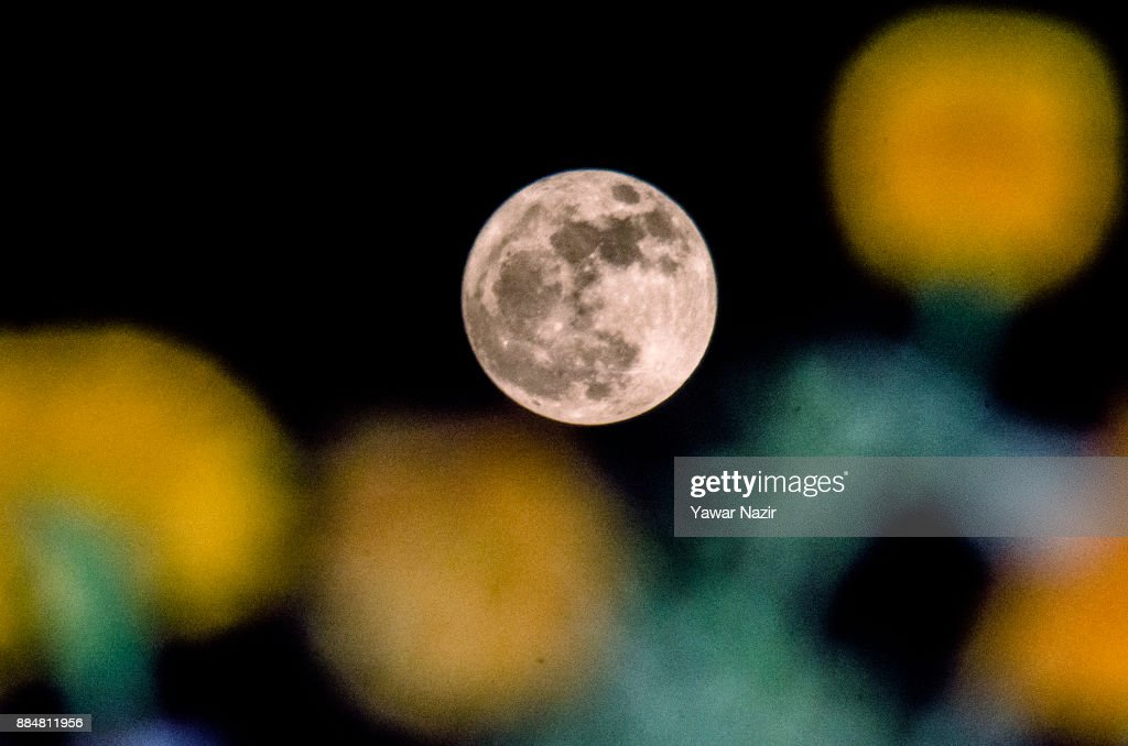 A full 'Supermoon' rises in the early hours of December 3, 2017 in Srinagar, the summer capital of Indian administered Kashmir, India. Supermoon is a condition when the Moon reaches its closest point to the Earth and appears much brighter and bigger.
