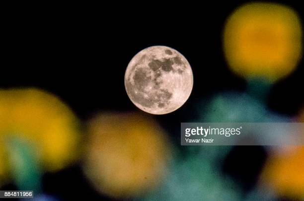 A full 'Supermoon' rises in the early hours of December 3 2017 in Srinagar the summer capital of Indian administered Kashmir India Supermoon is a...