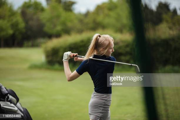 full swing at the golf course - golf stock pictures, royalty-free photos & images
