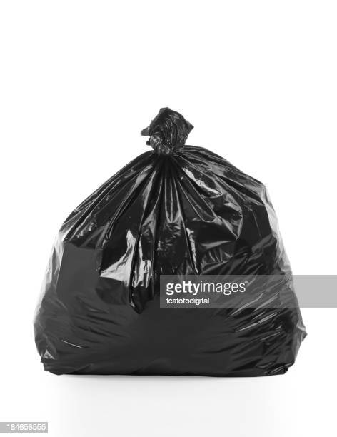 Full, tied trash bag on white background