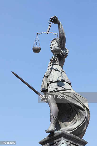 full view  ancient lady justice justitia against perfect blue sky - lady justice stock pictures, royalty-free photos & images