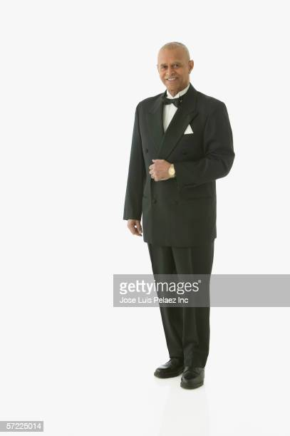 Full view portrait of man in tuxedo
