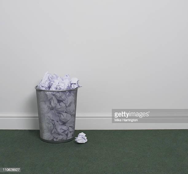 Full Waste Paper Bin In Office