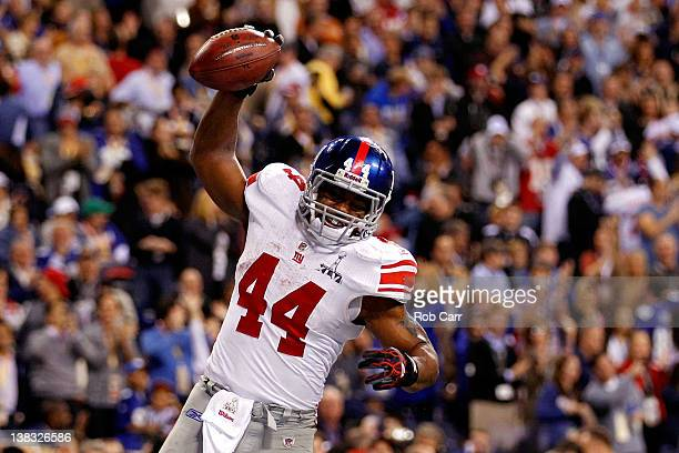 Fullback Ahmad Bradshaw of the New York Giants celebrates his sixyard touchdown run in the fourth quarter against the New England Patriots during...