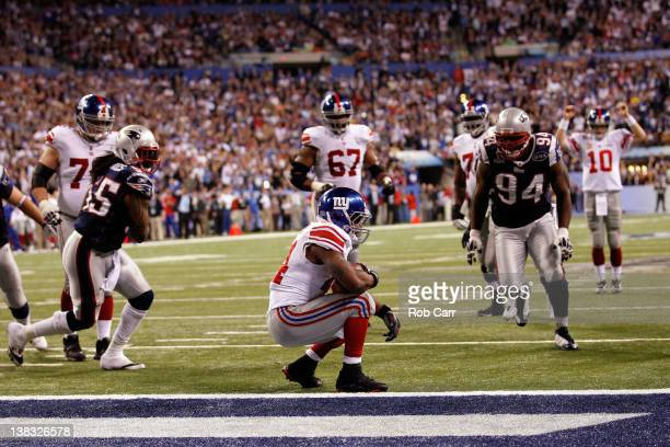 Fullback Ahmad Bradshaw of the New York Giants scores on a sixyard touchdown run in the fourth quarter against the New England Patriots during Super...