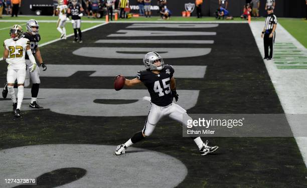 Fullback Alec Ingold of the Las Vegas Raiders spikes the football in the end zone after scoring a touchdown against the New Orleans Saints during the...