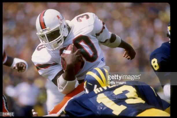 Fullback Alonzo Highsmith of the Miami Hurricanes runs with the ball during a game against the Michigan Wolverines at Michigan Stadium in Ann Arbor...