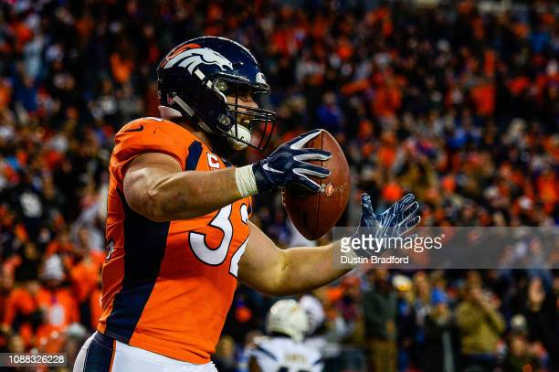 Fullback Andy Janovich of the Denver Broncos celebrates a touchdown on a fourth reception against the Los Angeles Chargers at Broncos Stadium at Mile...