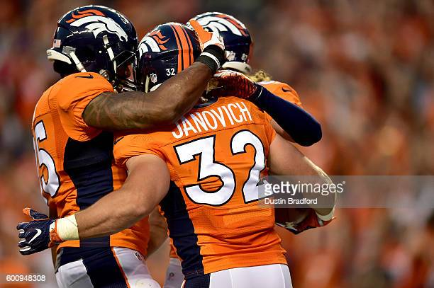 Fullback Andy Janovich of the Denver Broncos celebrates with teammates after he scores on a 28yard touchdown run against the Carolina Panthers in the...