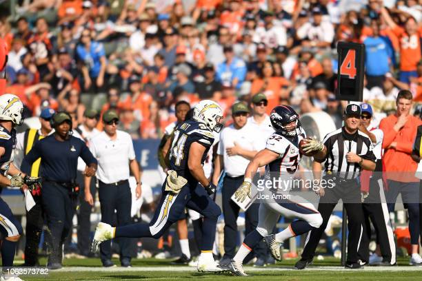 Fullback Andy Janovich of the Denver Broncos gets the first down on a fake punt against the Los Angeles Chargers at the StubHub Center November 18...