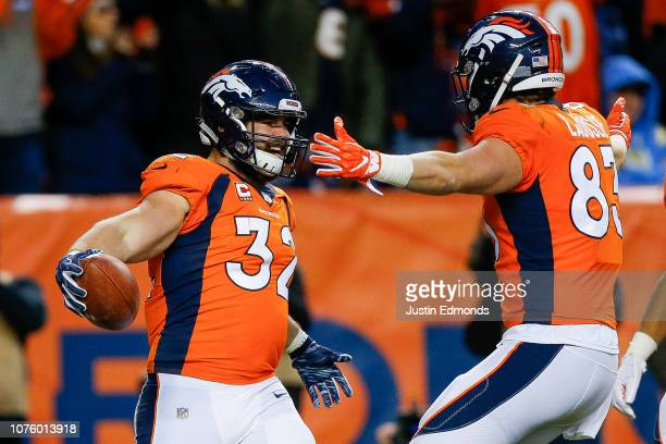 Fullback Andy Janovich of the Denver Broncos is congratulated by tight end Matt LaCosse after a fourth quarter touchdown against the Los Angeles...